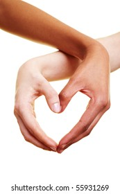 Two hands form a heart shape with their fingers