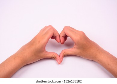 Two hands form a love shape symbol isolated against white background.