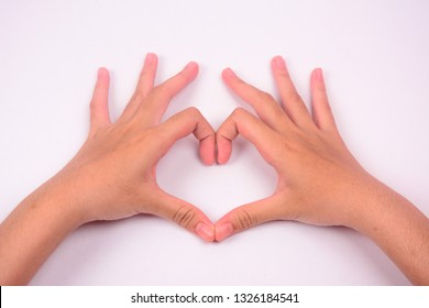 Two hands forming a love shape symbol isolated against white background.