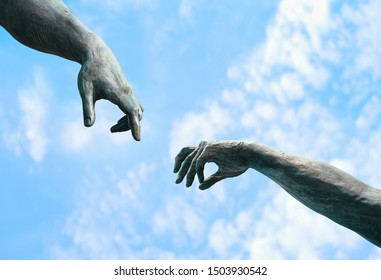 two hands, fragment of old statue. hands reaching each other with fingers against sky background. touch, contact, art minimal symbol. Creation of Adam metaphor by Michelangelo - Shutterstock ID 1503930542