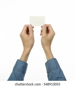two hands giving out a blank namecard, isolated white background - Shutterstock ID 548913055