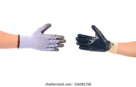 Two hands gloves meet in hand shake. Isolated on a white background.