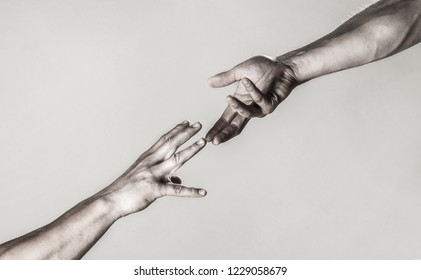 Two hands, helping arm of a friend, teamwork. Helping hand outstretched, isolated arm, salvation. Close up help hand. Helping hand concept and international day of peace, support. Black and white.