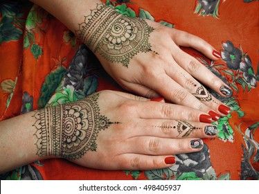 two hands with henna tattoos mehendi designs
