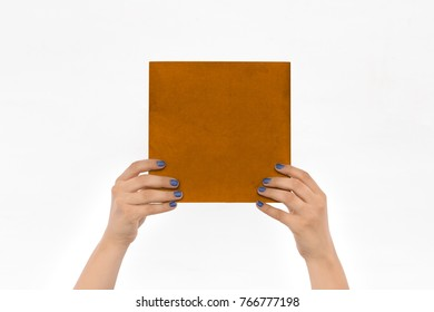 Two hands are holding up a book of paper on an isolated background