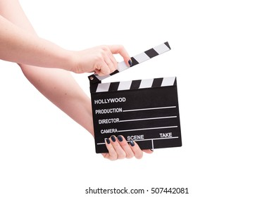 Two hands holding a cinema clap isolated on white