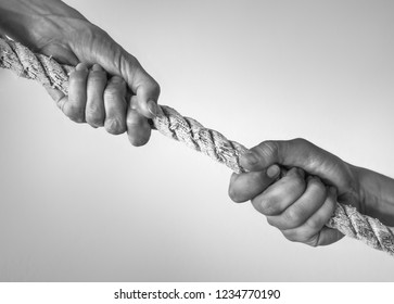 Two hands holding a climbing rope, strength and determination. Rescue, help, people friendship concepts.