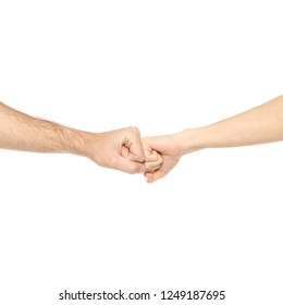 Two hands holding each other strongly fists on white background isolation