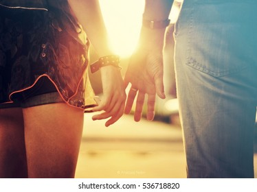 Two hands holding each other.Boyfriend and girlfriend,Couple,engagement