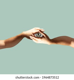 Two hands holding eye pupil on pastel green background. Modern design, contemporary art collage. Inspiration, idea, trendy urban magazine style. Negative space to insert your text or ad. Minimalism. - Shutterstock ID 1964873512