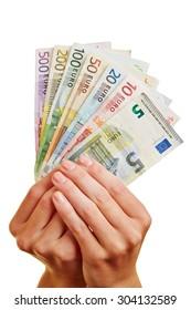 Two hands holding fan of Euro money bills