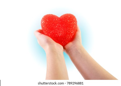 Two hands holding an outstretched heart in openness and love. Love, health and giving concepts