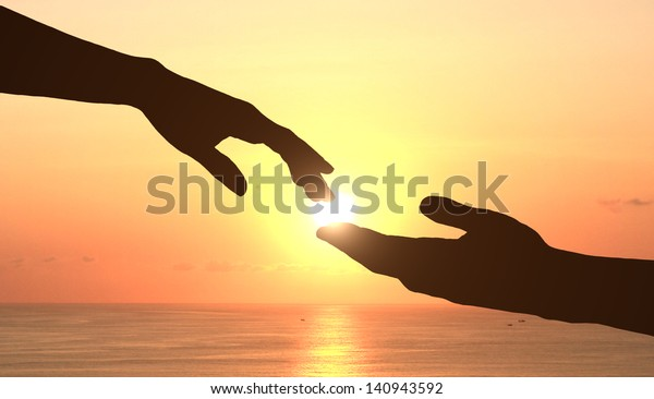 two hands holding puzzle