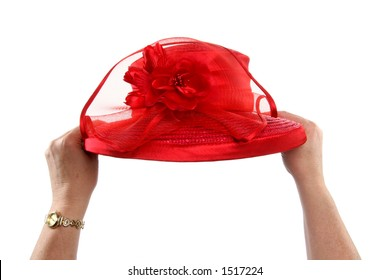 two hands holding red hat