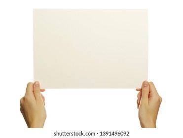 Two hands are holding up a white piece of paper on an isolated background