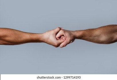 Two hands, isolated arm, helping hand of a friend. Friendly handshake, friends greeting. Rescue, helping hand. Male hand united in handshake. Man help hands, guardianship, protection.