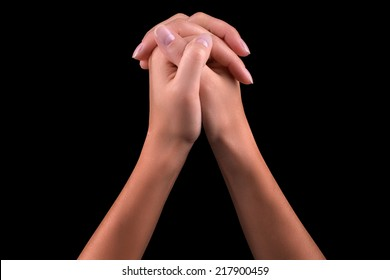 Two hands  isolated on a black background, praying