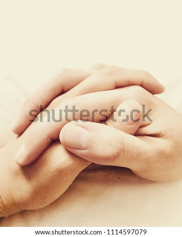 two hands joined together one stock photo edit now 1114597079