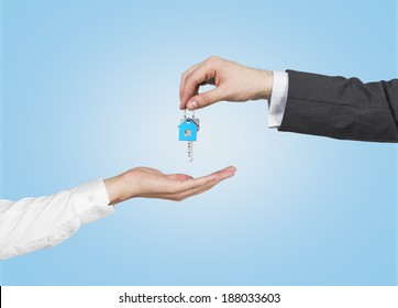 Two hands and a key. Blue background,