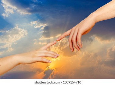 """Two hands on a light background, a replica of the plot of Michelangelo's """"The Creation of Adam"""""""