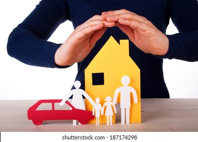 Two Hands are Protecting a Family infront of its House with their Car, Isolated