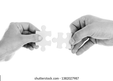 two hands with puzzle and white background