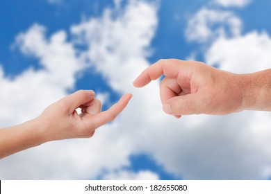 Two hands reach each other in