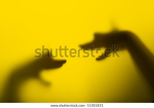 Two hands in the theater of the shadow presents talking dog's heads