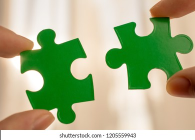 two hands trying to connect couple puzzle piece. business strategy concept team support