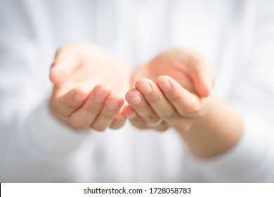 Two hands of a young women