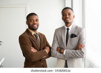 two handsome african men in suits at the office