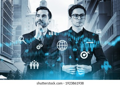Two handsome businessman in suits thinking about career opportunities at research and development department at international consulting company. Hologram icons over Singapore background.
