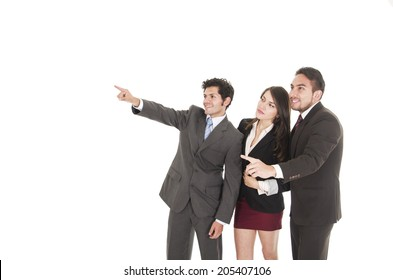 two handsome businessmen and a businesswoman in suits posing pointing empty space