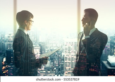 Two handsome businessmen on city background with sunlight. Teamwork concept. Double exposure