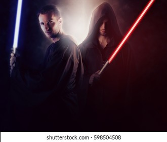 Two handsome warrior holding a light saber