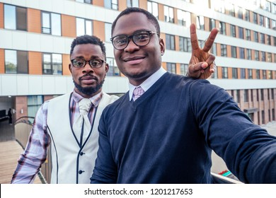 two handsome and young african american men making selfie portrait on smartphone in the airport