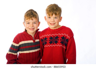 Two handsome young boys happy and playful.