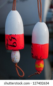 Two hanging buoys with boat bow in background