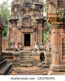 Two Hanuman statues guard the entrance of the Khmer temple in Angkor Wat park, Cambodia.