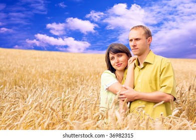 Two happiness people on the golden wheat field