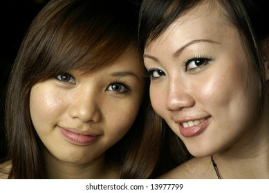 Two happy asian lady friends