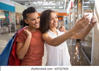 Two Happy Black Girls Taking Selfie Photo in Mall