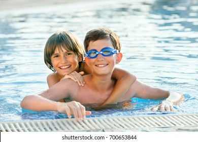 two happy boys in the swimming pool