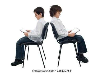 Two happy boys using digital tablets