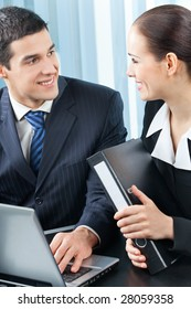 Two happy businesspeople working at office