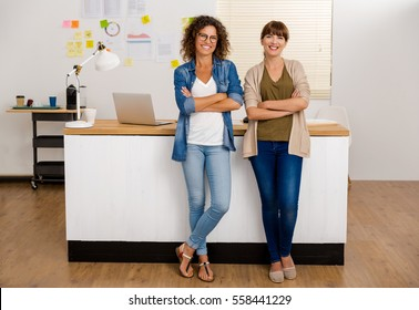Two happy businesswoman working together in an office