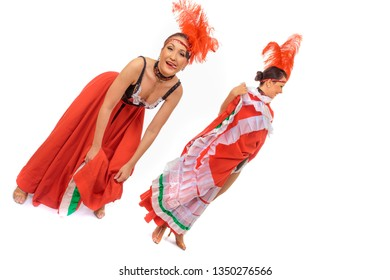 Two happy cancan dancers get ready to perform