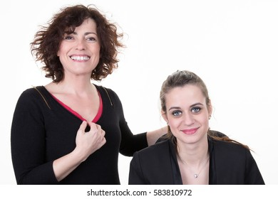 Two happy and cheerful business woman isolated on white
