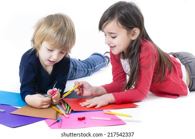 Two happy children doing homework