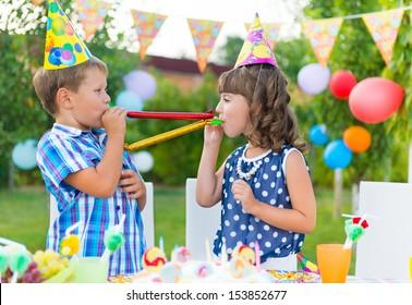 Two happy children having fun at birthday party